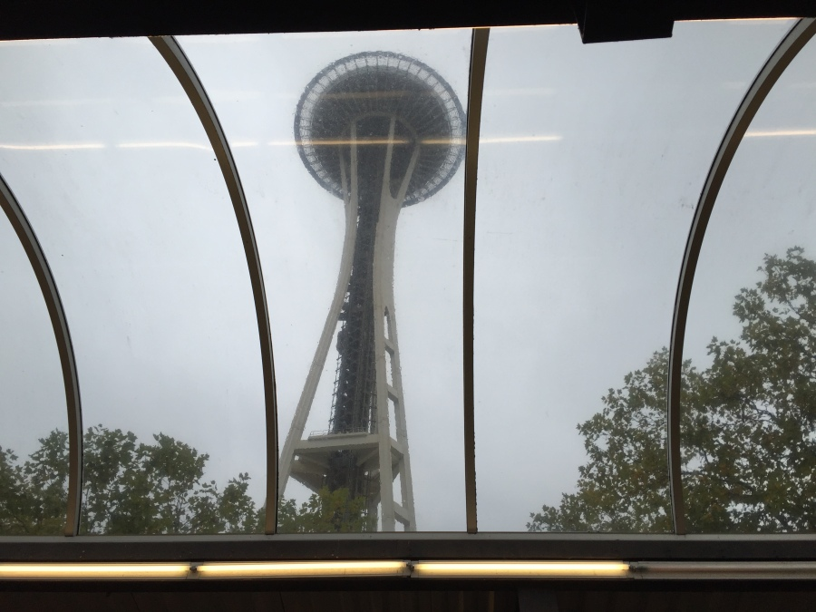 The Seattle Space Needle is visible through the monorail terminal skylights.